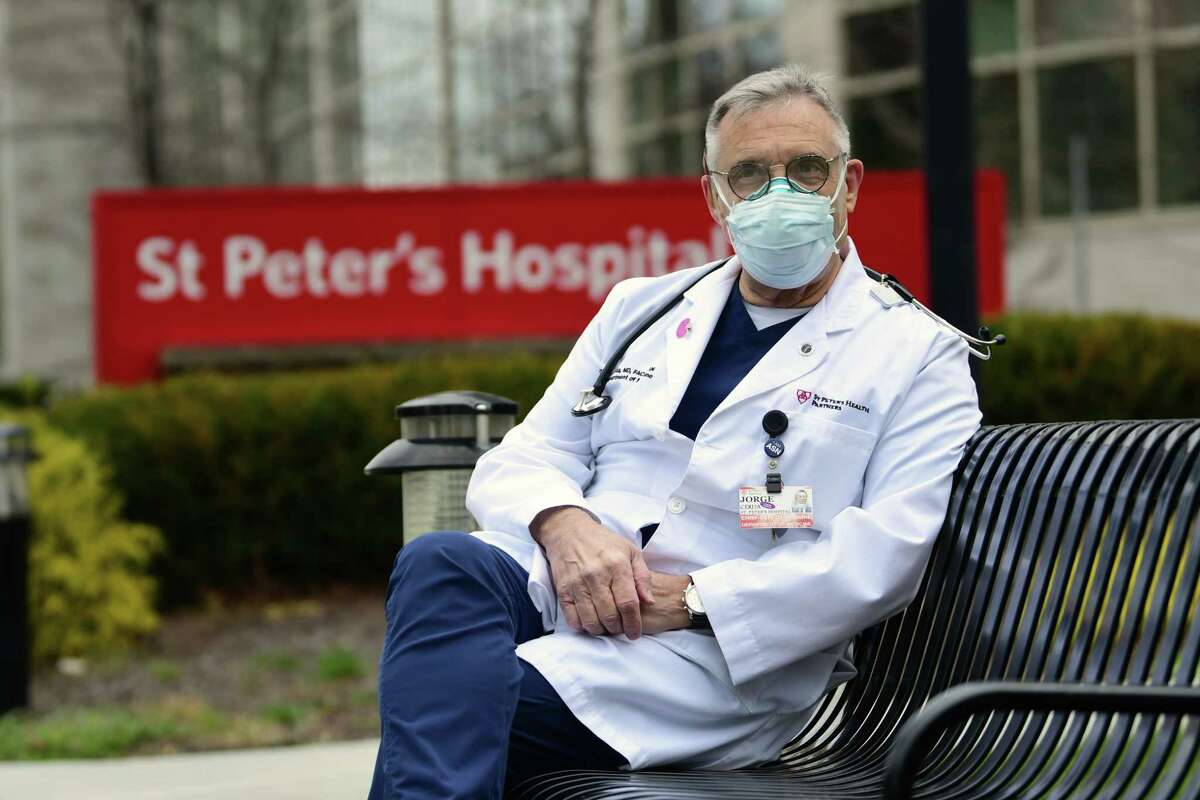 Dr. Jorge Cerda, chief of the Department of Medicine at St. Peter?•s Hospital, sits outside the hospital on Wednesday, Nov. 25, 2020 in Albany, N.Y. Dr. Cerda has been treating COVID-19 patients since the start of the pandemic. (Lori Van Buren/Times Union)