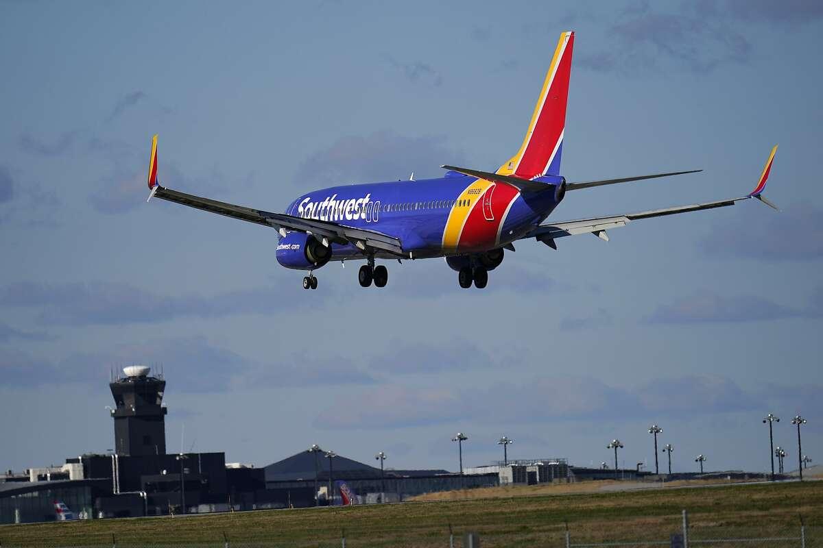 A Southwest Airlines flight from Bradley International Airport makes its landing approach onto Baltimore-Washington International Thurgood Marshall Airport, Monday, Nov. 23, 2020, in Glen Burnie, Md. (AP Photo/Julio Cortez)