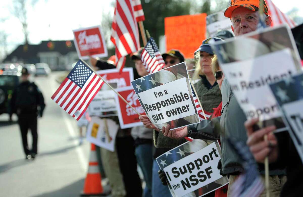 Supporters for gun rights gather outside the National Shooting Sports Foundation headquarters in Newtown, Conn., Thursday, March 28, 2013.