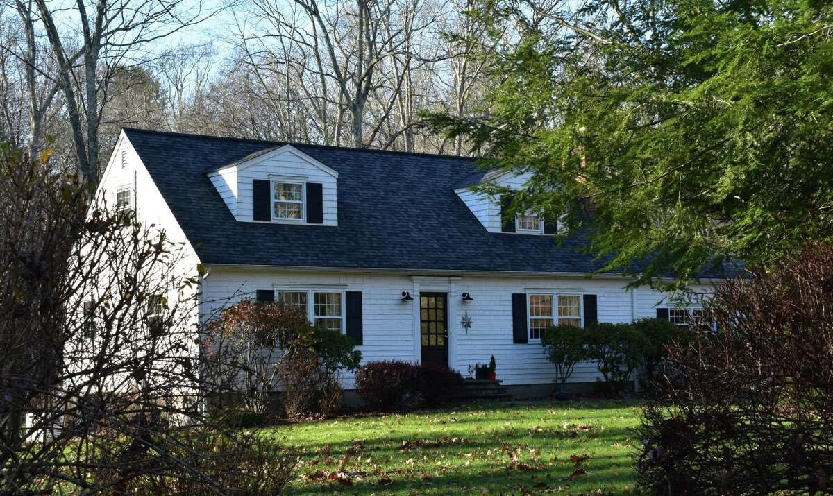 A newly listed home for sale on Buttonball Lane in Weston, Conn., in early December 2020 amid a continuing surge in real estate sales to close out the year.