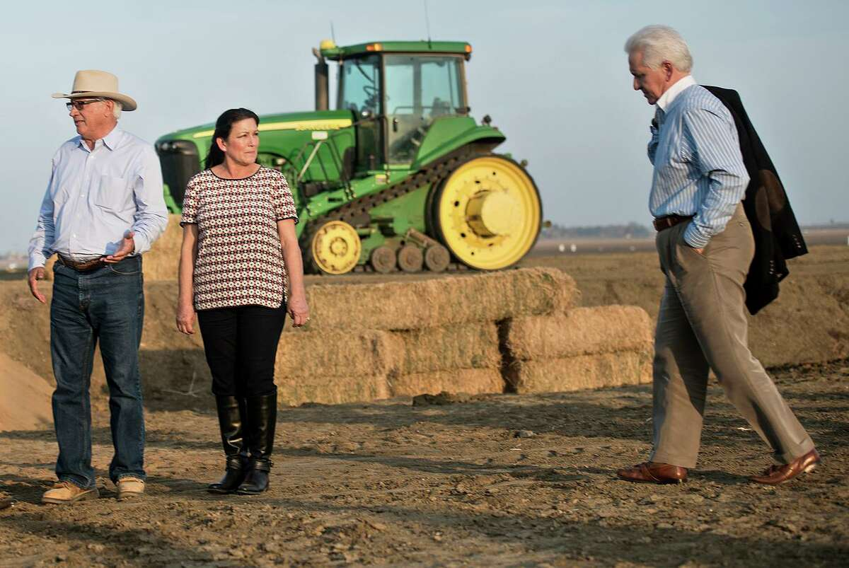 Rep. Jim Costa, D-Fresno, right, meets with Joe and Maria Gloria Del Bosque on their farm in 2014. Costa lost his bid Thursday to chair the powerful House Agriculture Committee.