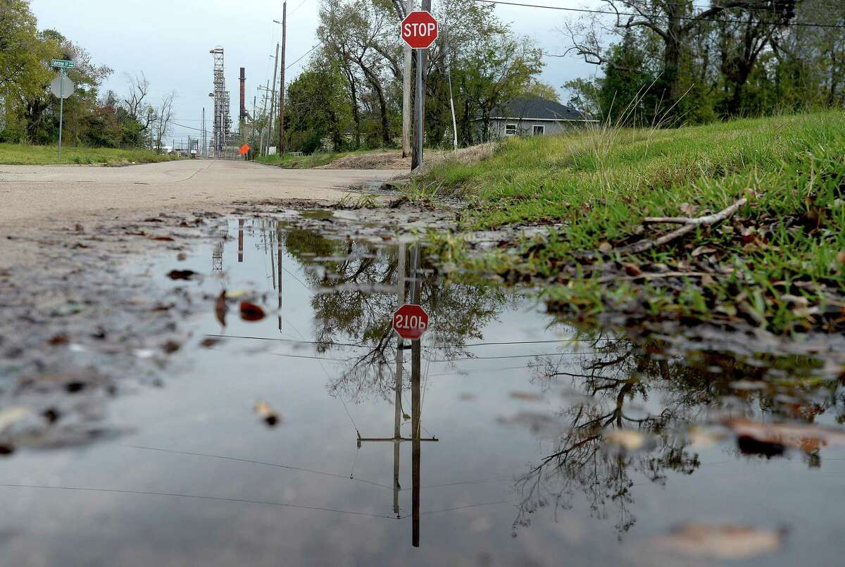 Standing water and debris from recent drainage problems in the wake of heavy rainfalls remain on Lamar Street in the Charlton Pollard neighborhood. Roadways near the Port of Beaumont have experienced unprecedented flooding, and a temporary fix is in place as the city assesses the root of the problem. Photo taken Thursday, December 3, 2020 Kim Brent/The Enterprise