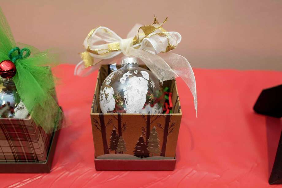 An ornament with the footprint of a 10-week-old that is being assisted by Family Promise. The ornament was one of many that was sold during a live auction at the Christmas Celebration Saturday, Dec. 7, 2019. Photo: Gustavo Huerta, Houston Chronicle / Staff Photographer / Houston Chronicle