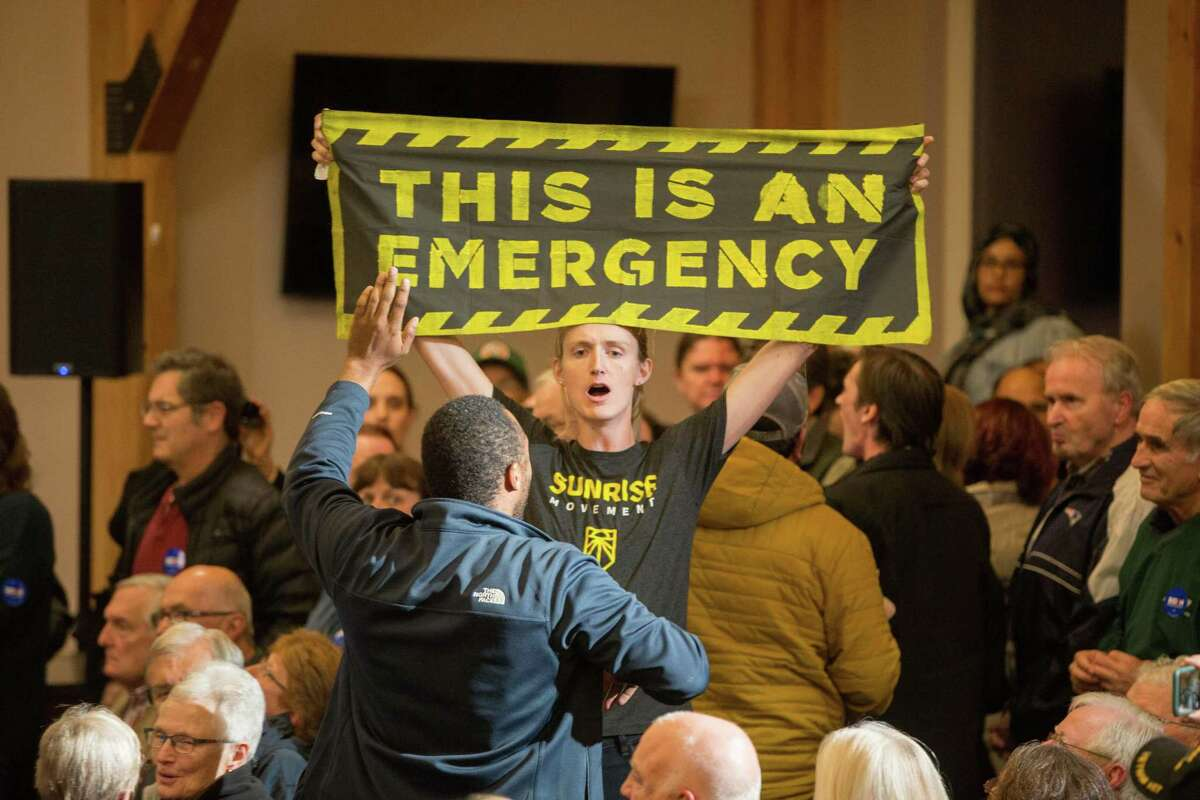 Climate change protesters disrupt Democratic presidential candidate, former Vice President Joe Biden during a campaign event on October 9, 2019 in Manchester, New Hampshire. For the first time, Biden has publicly called for President Trump to be impeached.