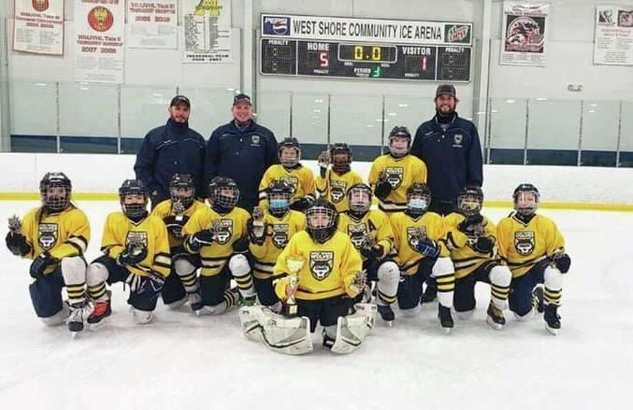 The West Shores Wolves 10U Squirts teamwent 4-0 in tournament play to winthe Fenstermacher Cup Championship at West Shore Community College last month. (Courtesy photo)