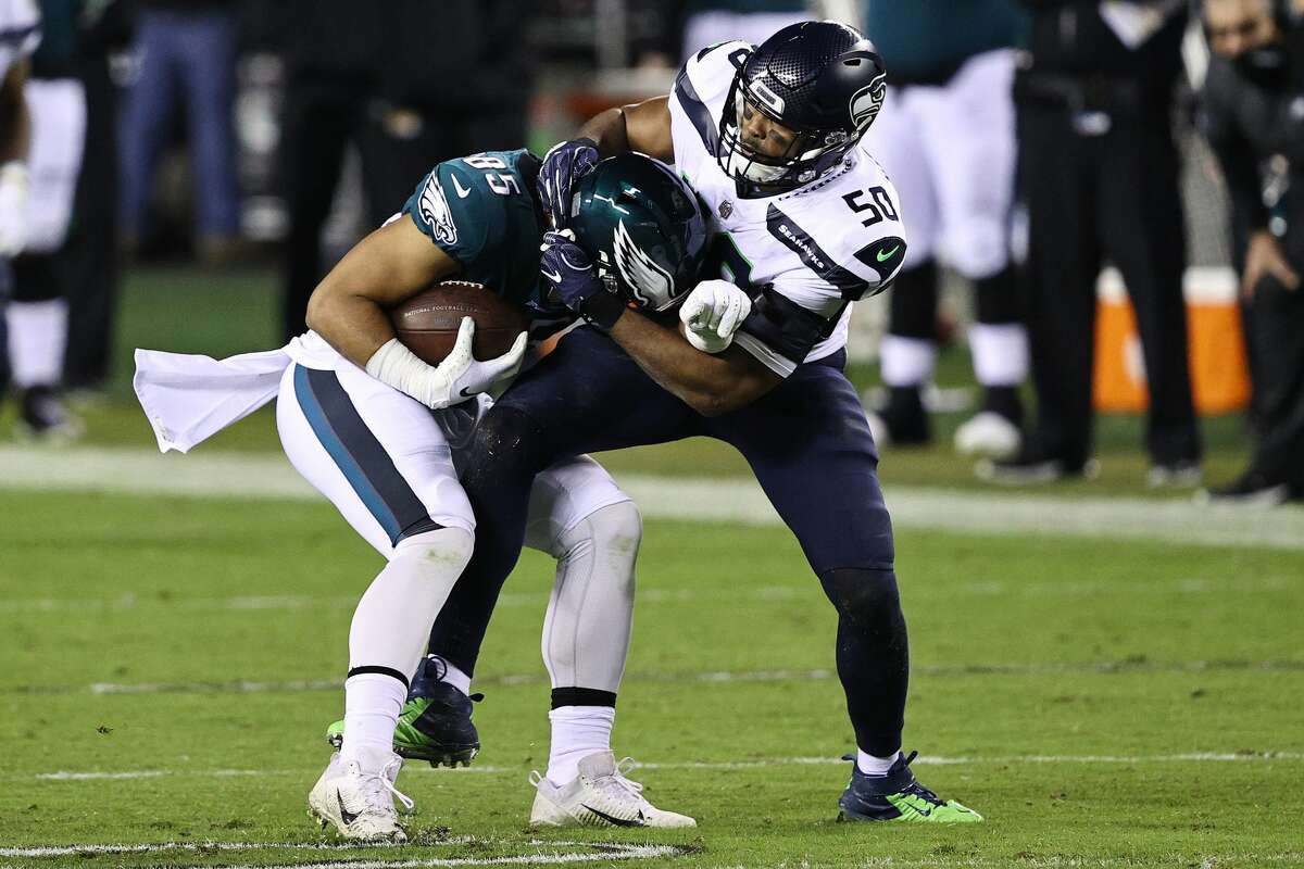 PHILADELPHIA, PENNSYLVANIA - NOVEMBER 30: Richard Rodgers #85 of the Philadelphia Eagles is tackled by K.J. Wright #50 of the Seattle Seahawks during the third quarter at Lincoln Financial Field on November 30, 2020 in Philadelphia, Pennsylvania. (Photo by Elsa/Getty Images)