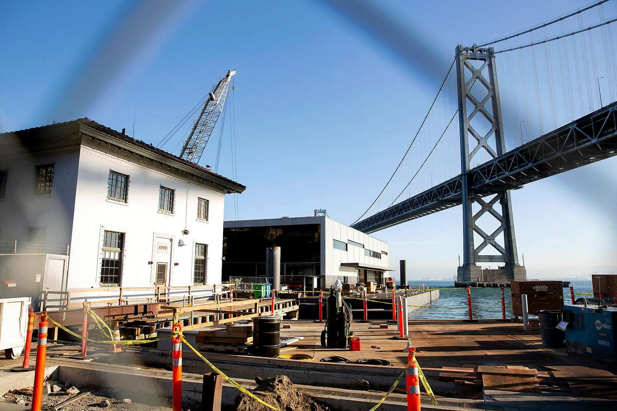 Construction crews continue work on Fireboat Station 35 after it's put into place along the Embarcadero after making it's way from Treasure Island in San Francisco, Calif. on Thursday, December 3, 2020. Fireboat Station 35 will house the San Francisco Fire Department's three fireboats and rescue watercraft, replacing the existing 105-year-old fire station on the Embarcadero, according to the city's Public Works department.