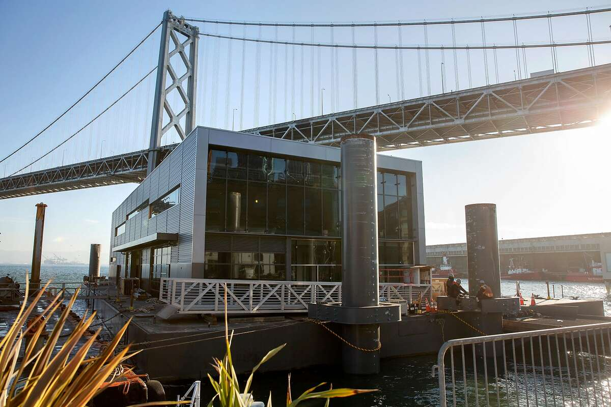 """Construction crews work on the new Fire Station 35 after the """"boat"""" made its way from Treasure Island on a steel frame built in China."""