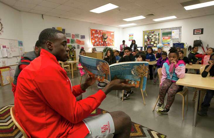 UH football players Ed Oliver and Steve Dunbar (foreground) read to a UH Charter School classroom during Read Across America Day Thursday, March 2, 2017, in Houston. Other UH players were Kyle Allen and Ra'Shaad Samples, Collin Wilder and Jerard Carter.( Steve Gonzales / Houston Chronicle )