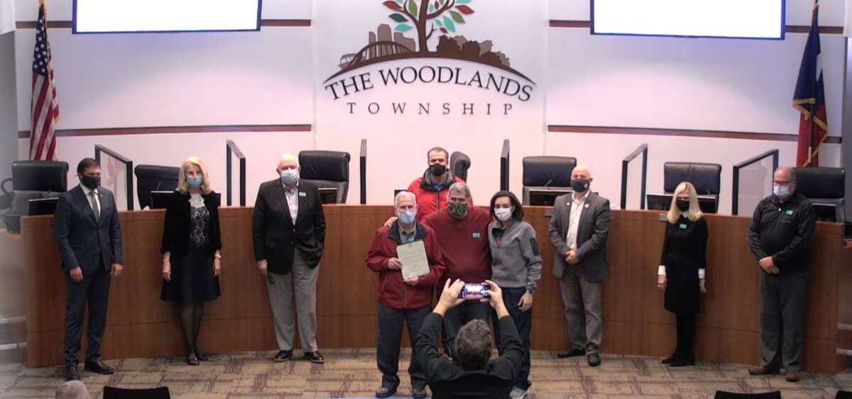 """The Woodlands Township Board of Directors hosted a short meeting on Wednesday, Dec. 2, 2020, at the township administrative offices. Among the items on the agenda was a proclamation for Donald Baker, the 89-year-old owner of the wildly popular Candy House. The store has recently seen a swell of support after a viral social media post called for help due to lagging sales because of the pandemic. Baker, holding the proclamation on left, said he was grateful for the """"overwhelming"""" support he's received."""
