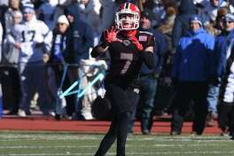 New Canaan's Zach LaPolice (7) makes a reception against Darien during the Turkey Bowl football game at Stamford's Boyle Stadium on Thanksgiving, Nov. 22, 2018.