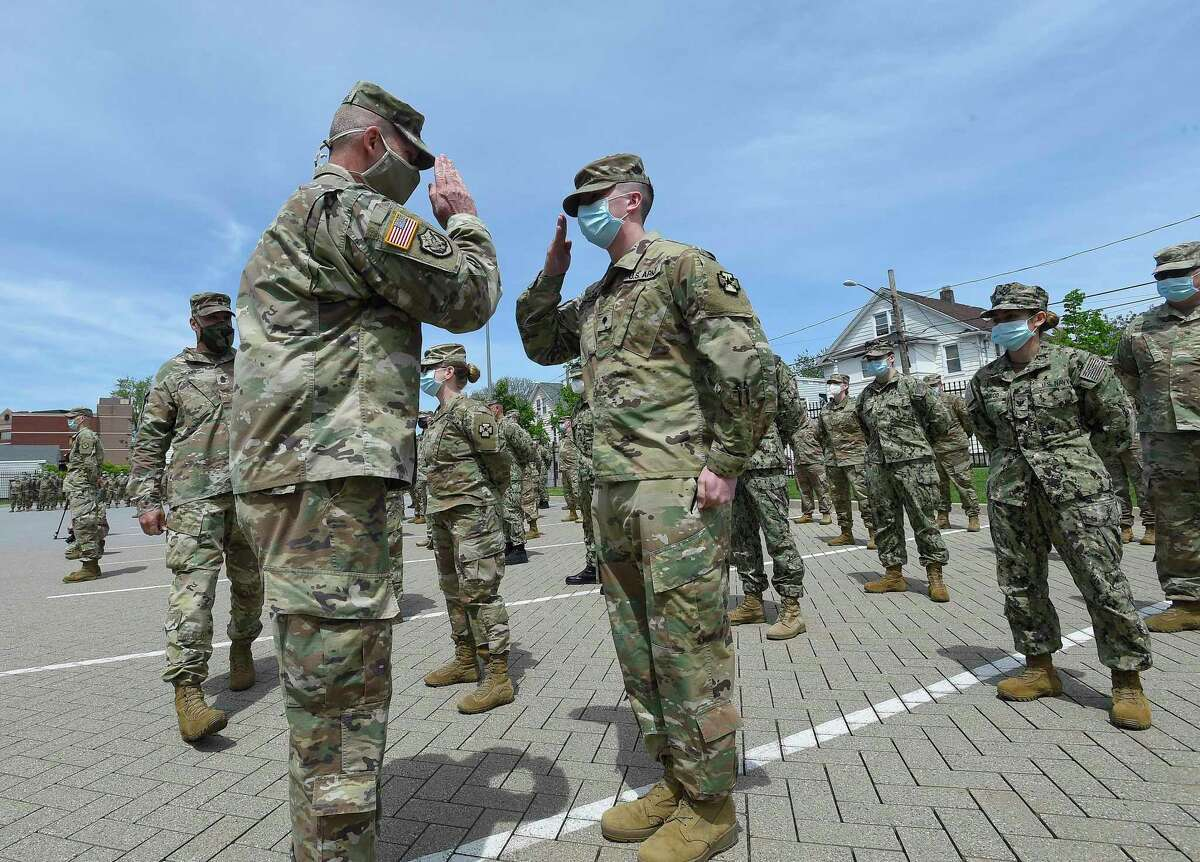 Military personnel making up Task Force 811-1 of the Connecticut National Guard and U.S. Army Reserves Urban Augmentation Medical Task Force (UAMTF) parade through the cheers and salutes of Thank You's from the Doctors, Nurses, support staff and administrators of Stamford Hospital on May 19, 2020 in Stamford, Connecticut. The military support from branches of the U.S. Army, Navy and Air Force Resevres from throughout the United States, as well as units of the Connecticut National Guard, spent six weeks at the hospital supporting, treating and caring for patients during the COVID-19 Pandemic.