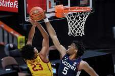 UConn's Isaiah Whaley, right, blocks a shot by USC's Max Agbonkpolo on Thursday night in Uncasville.