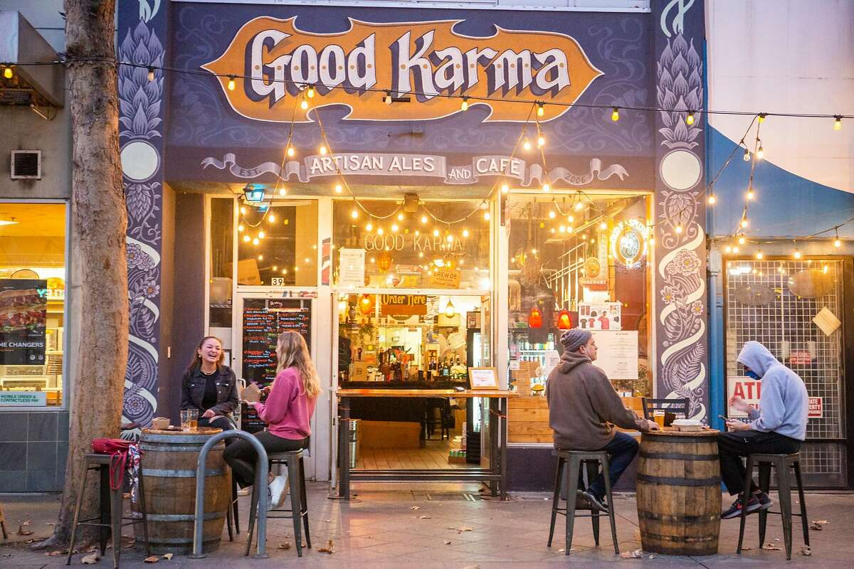 Customers enjoy their beverages at Good Karma in San Jose. However, under new orders issued by Gov. Gavin Newsom, in regions of the state where fewer than 15% of intensive care unit beds are available, many businesses, including bars and wineries, will have to shut down, and restaurants will be able to offer only takeout or delivery.