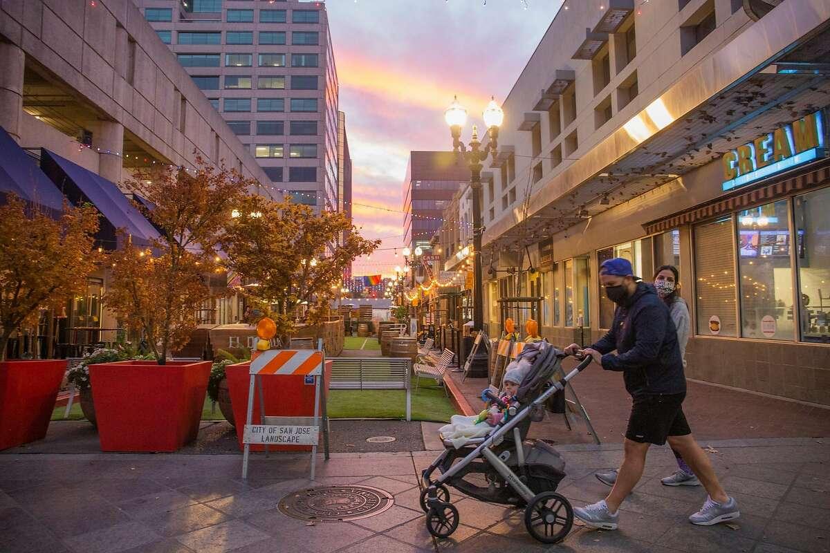Pedestrians enjoy a stroll in downtown San Jose, CA on December 3, 2020.