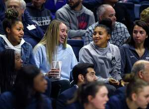 In attendance for UConn's game against Notre Dame on Sunday afternoon, Dec. 8, 2019 (left to right) are Amari DeBerry, Paige Bueckers, Azzi Fudd, and Caroline Ducharme. (Brad Horrigan/Hartford Courant/TNS)