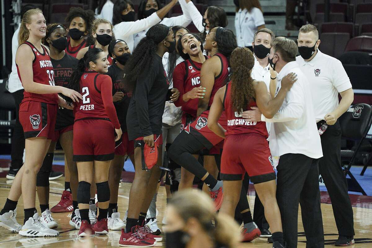 North Carolina State players celebrate their win over top-ranked South Carolina in Columbia, S.C., on Thursday. It was the Wolfpack's first win over a No. 1 team since 2007.
