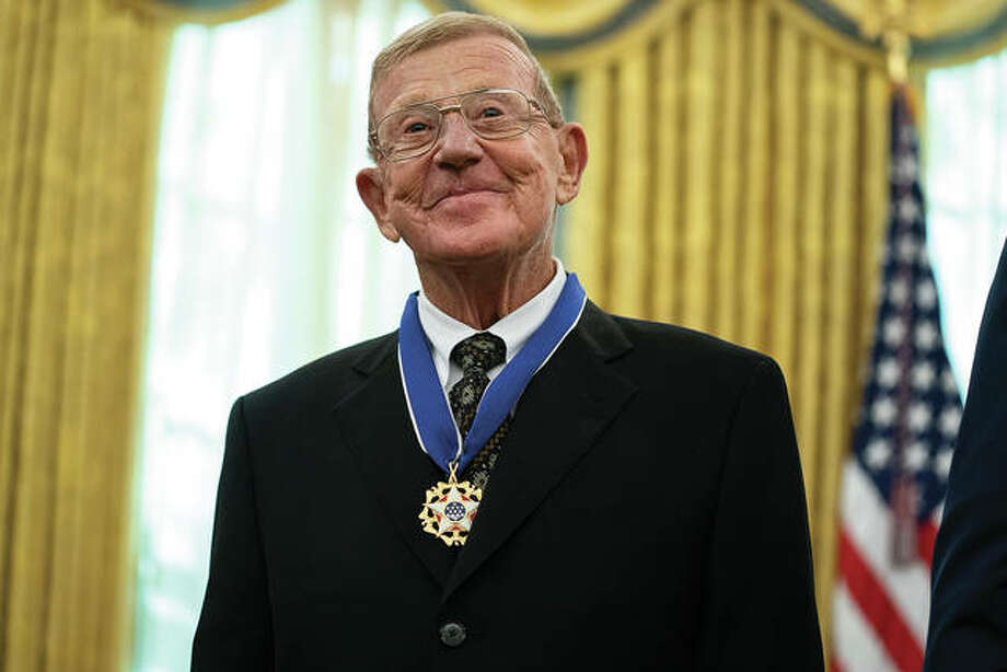 Former football coach Lou Holtz smiles after receiving the Presidential Medal of Freedom from President Donald Trump, in the Oval Office of the White House, Thursday, in Washington. Photo: Evan Vucci | Associated Press