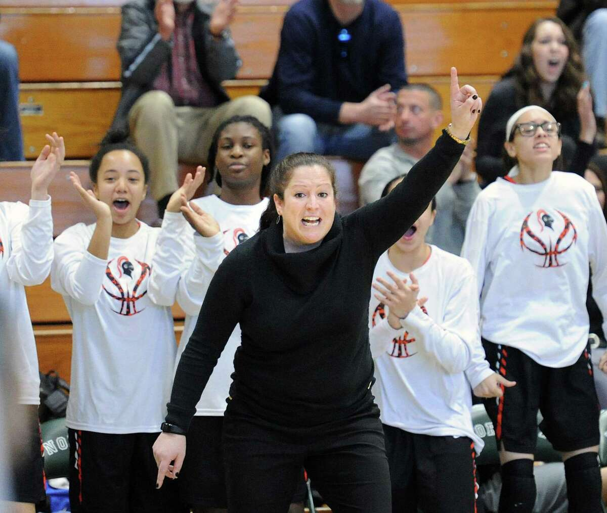 Stamford High School girls basketball coach Diane Burns, center, reacts during the FCIAC girls high school basketball quarter-final playoff game between Norwalk High School and Stamford High School at Norwalk, Conn., Saturday, Feb. 17, 2018.