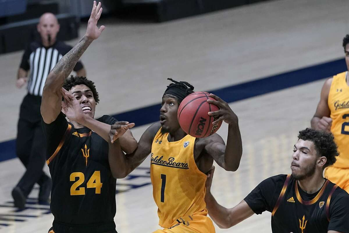Cal guard Joel Brown heads toward the basket between Arizona State's Jalen Graham (24) and Taeshon Cherry in the second half Thursday night in Berkeley.