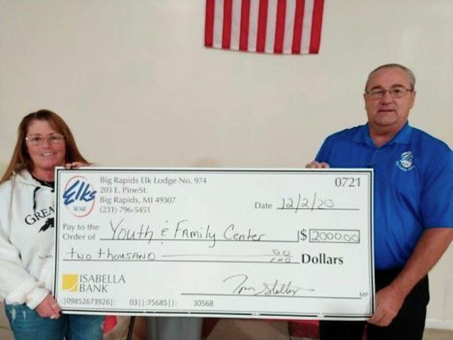The Big Rapids Elks Lodge recently made a $2,000 donation to the Mecosta Youth and Family Center to help cover the cost of all the additional COVID-19 supplies required. Center Executive Director Stacey Knoertzer said the donation will be used to purchase masks, hand sanitizer, touchless thermometers and the UV sanitizers needed. Elks Lodge President, Tom Stellard, said one of the Elks' focuses is supporting community youth programs and this fits that objective. Pictured from left is Stacey Knoertzer, executive director for the center, and Tom Stellard, president of the Big Rapids Elks Lodge. (Courtesy photo)