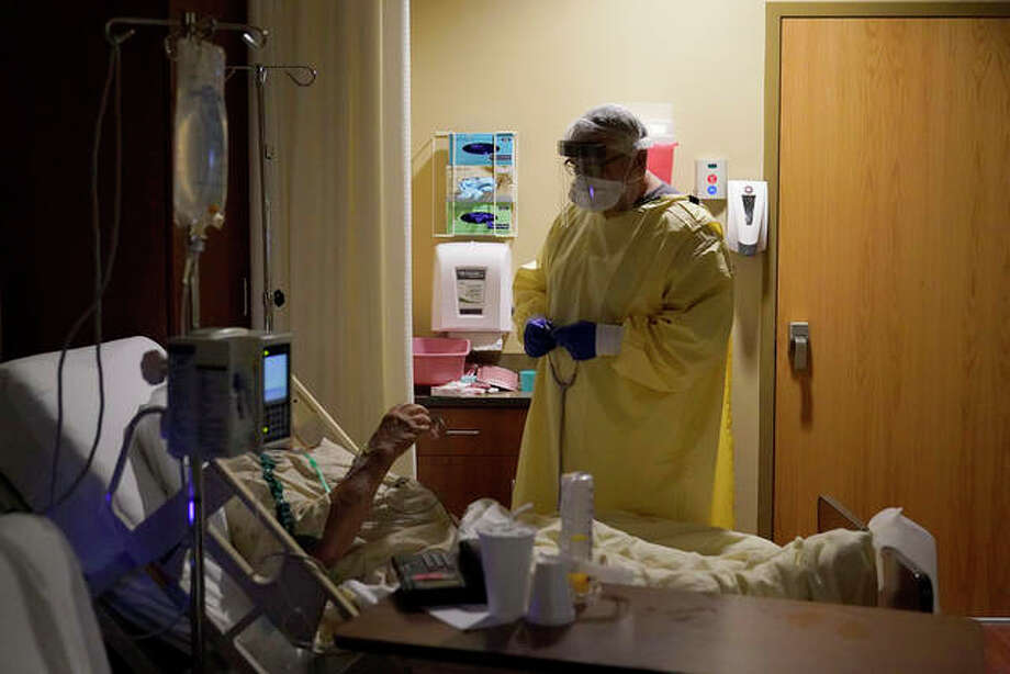 A doctor makes rounds in a hospital wing set up to isolate and treat COVID-19 patients. Photo: Jeff Roberson   AP