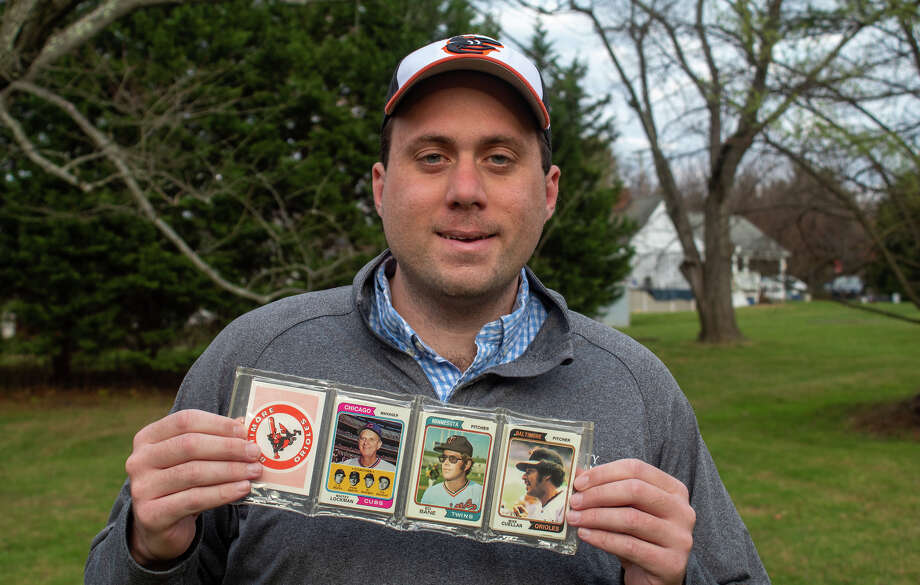 Eddie Healy with the 1974 Topps rack pack he saved from his dad's collection. Healy put the other 23 rack packs up for auction. Photo: Courtesy Of Eddie Healy / Handout