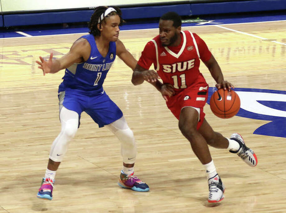 SIUE guard Courtney Carter, right, tries to get past SLU guard Yuri Collins during the season opener for both teams on Nov. 25 in St. Louis. Photo: Greg Shashack|Hearst Illinois