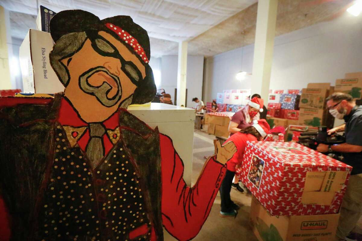 A large cutout of Pancho Claus greeted volunteers that came to the aid of Richard Reyes, who for the first time is asking for help to continue the holiday tradition of spreading joy to underprivileged children Saturday, Nov. 14, 2020, in Houston.