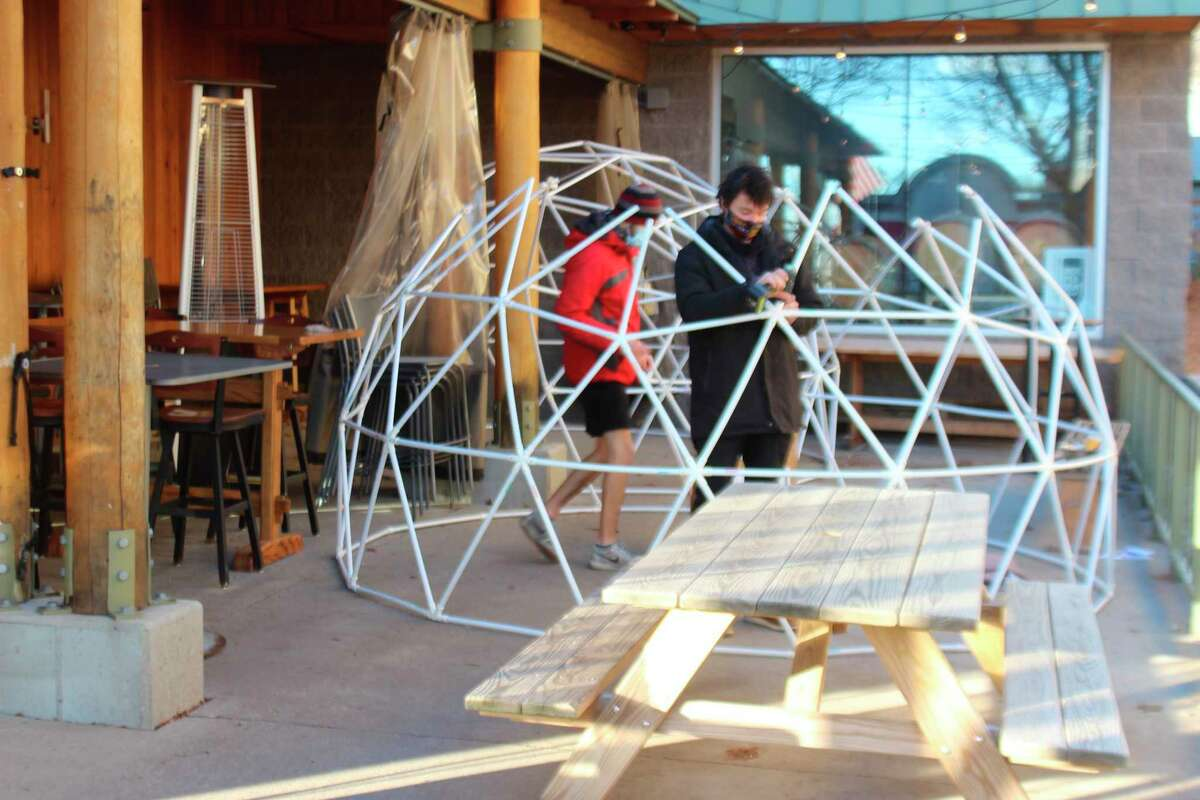 Stormcloud Brewing employees build domes to provide heated outdoor seating for up to six people at the pub's downtown Frankfort location. (Photo/Colin Merry)