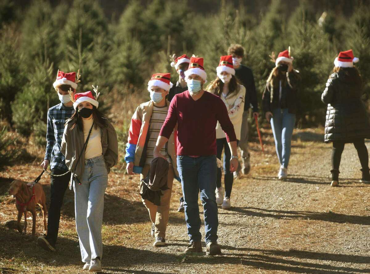 The Hart family from Newtown wear Santa hats as they head out to cut their own Christmas .