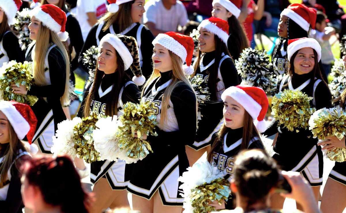 Conroe High School cheerleaders wear festive hats during the annual Christmas parade through downtown Conroe, Saturday, Dec. 14, 2019. This year's parade is Saturday, Dec. 12, at 1 p.m. in downtown Conroe.