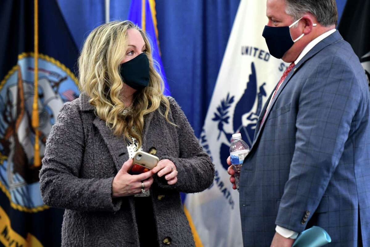 Albany County Department of Health Commissioner Dr. Elizabeth Whalen, left, and Albany County Executive Dan McCoy, right, confer following a county coronavirus news briefing on Friday morning, Dec. 4, 2020, at the county offices in Albany, N.Y. The county recorded 185 new cases overnight and now has 96 residents hospitalized with the disease, both the highest since the pandemic began. (Will Waldron/Times Union)