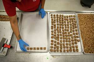 Marissa Carrasco makes sweets for the holiday season Thursday, Dec. 3, 2020 at Susie's South Forty Confections.   Jacy Lewis/Reporter-Telegram