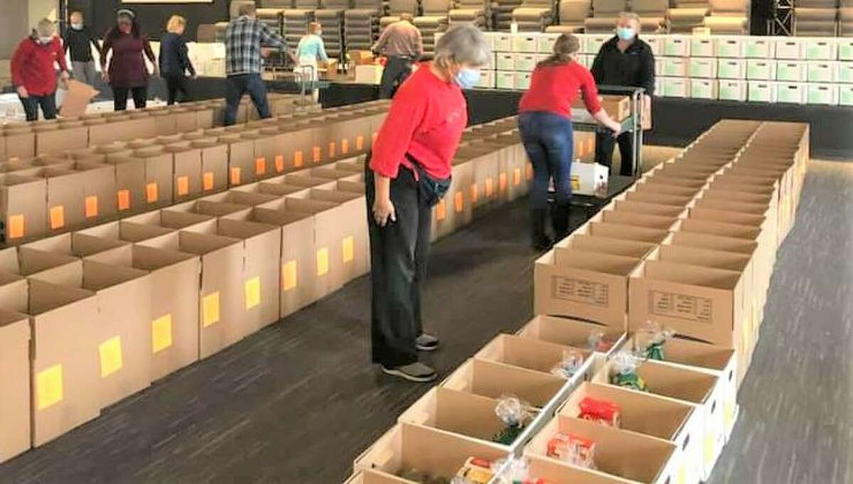 More than 100 volunteers helped prepare 973 baskets of food as part of the recent Middletown Community Thanksgiving Project. Over 70 businesses and organizations donated food, time or money to the cause.