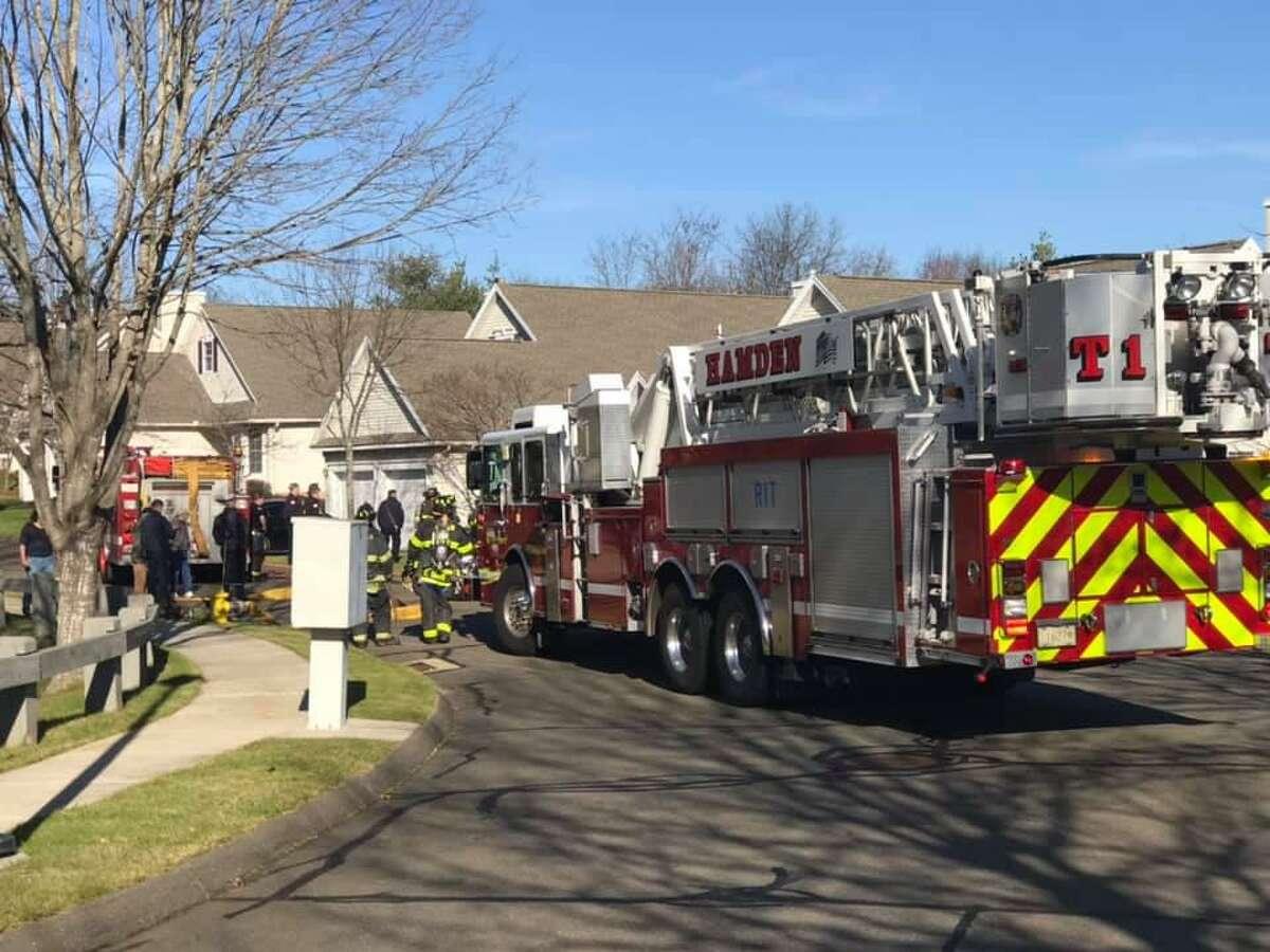 Crews on scene for a garage fire in Hamden, Conn., on Thursday, Dec. 3, 2020.