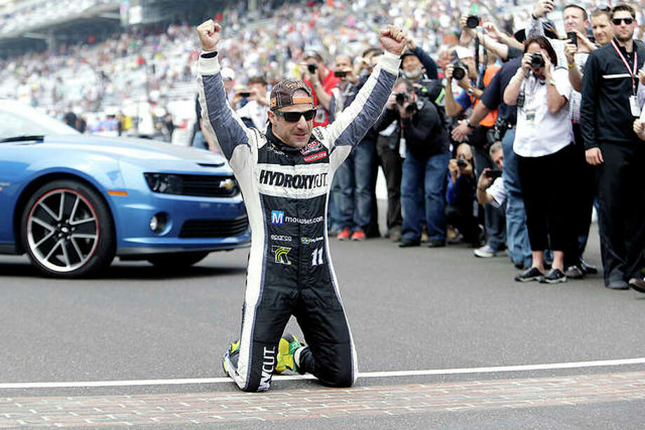 Tony Kanaan, of Brazil, celebrates on the gfames yard of bricks at the start/finish line after winning the 2013 Indianapolis 500. Kanaan will drive in next year's Bommarito 500 at World Wide Technology Raceway in Madison. Photo: Associated Press