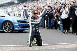 Tony Kanaan, of Brazil, celebrates on the gfames yard of bricks at the start/finish line after winning the 2013 Indianapolis 500. Kanaan will drive in next year's Bommarito 500 at World Wide Technology Raceway in Madison.
