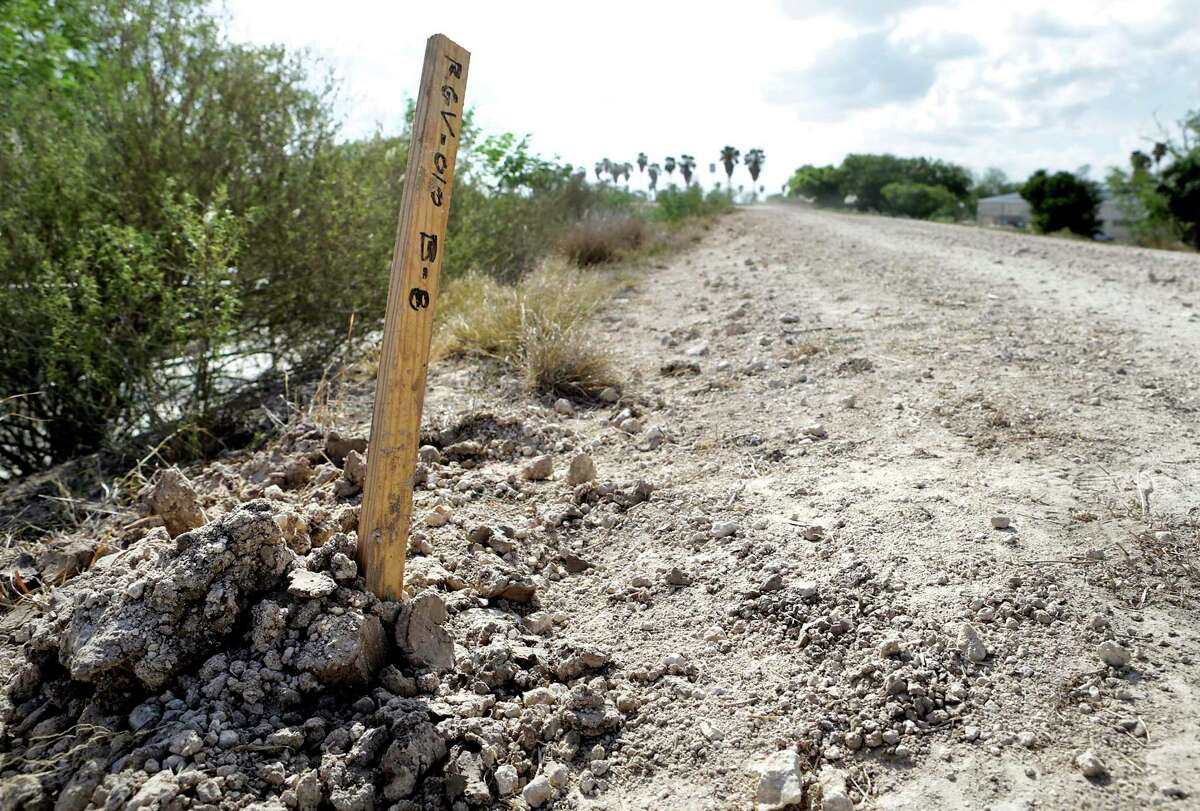 A stake marker shows where engineers have taken soil sample on the levee in the Santa Ana National Wildlife Refuge near Alamo, TX, in preparation to build the proposed border wall, on Tuesday, July 18, 2017.