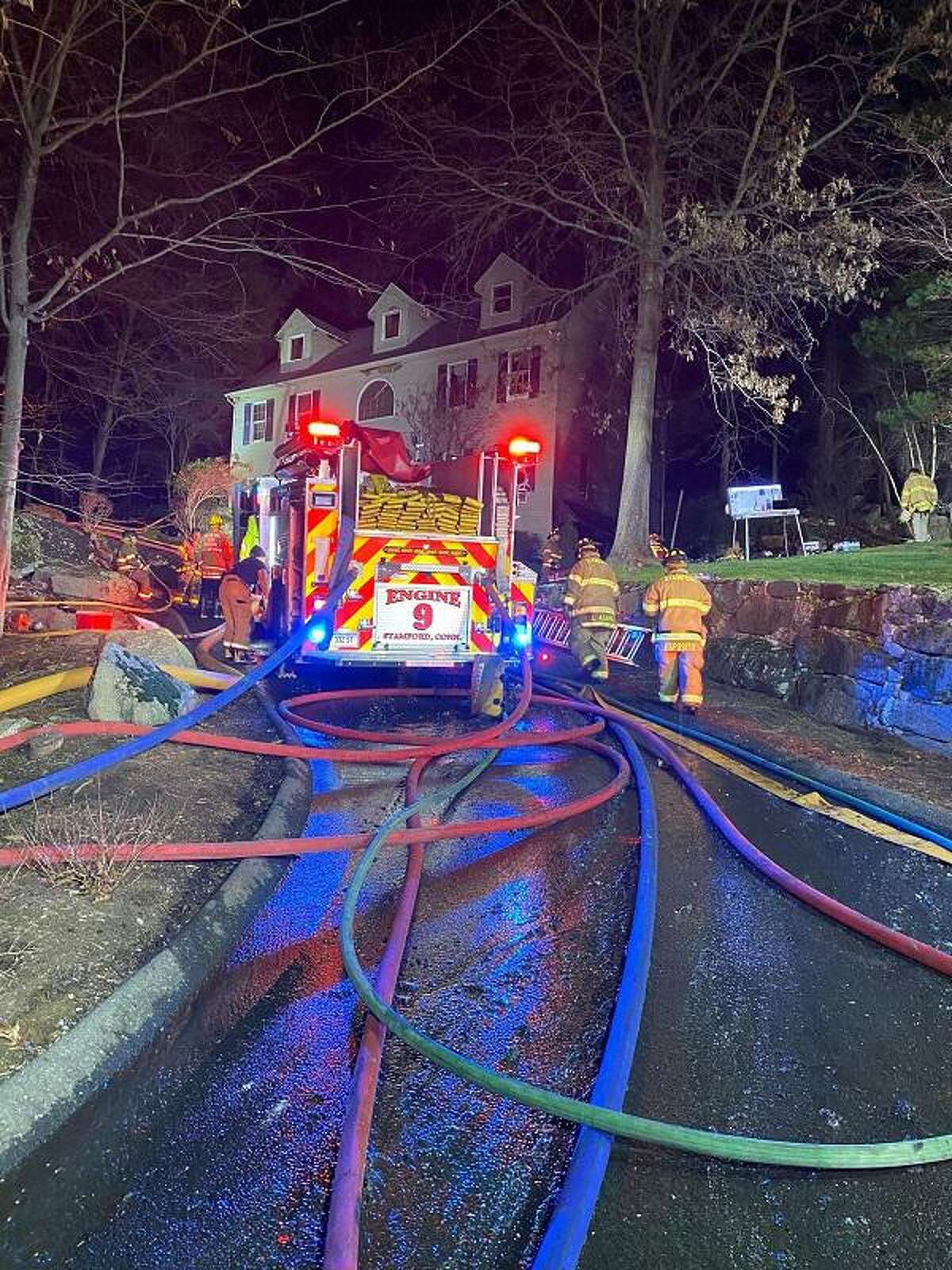 Crews at the scene of a fire in Stamford, Conn., on Friday, Dec. 4, 2020.