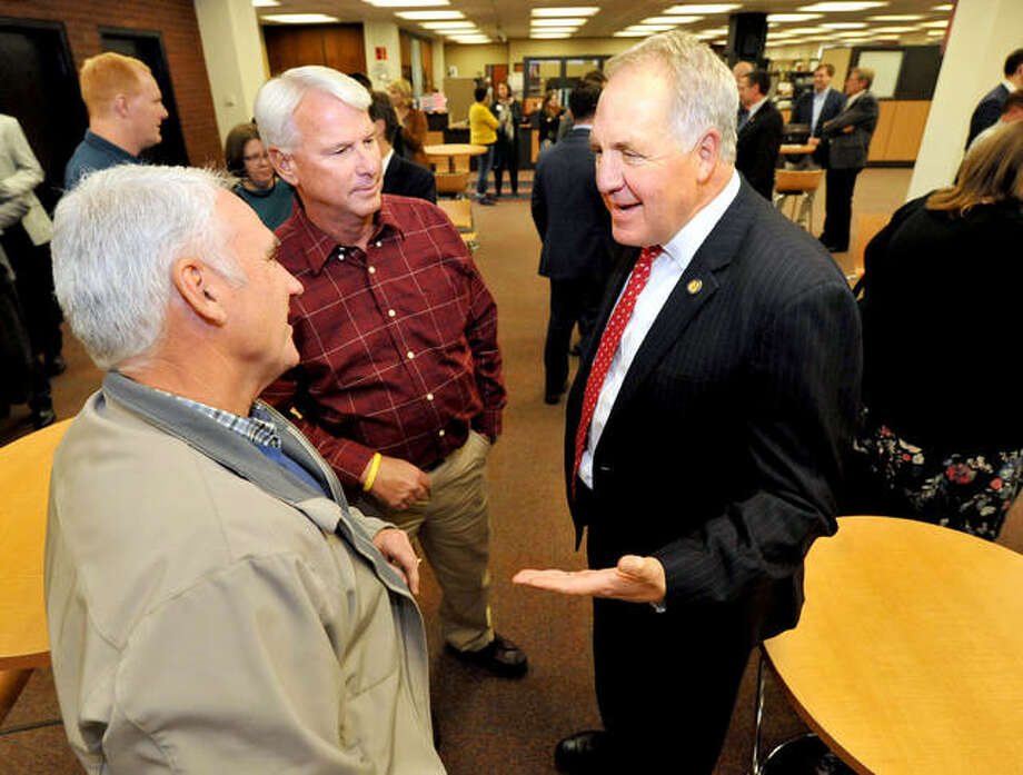 U.S. Congressman John Shimkus, right, talks with Steve Barker, left, and Randy Shroyer at the Lovejoy Library at SIUE before a presentation last year. Photo: Intelligener File Photo