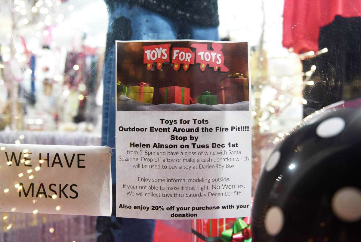 Toys to be donated are collected at the Toys for Tots holiday fundraiser at Helen Ainson in Darien, Conn. Tuesday, Dec. 1, 2020. The boutique clothing shop usually holds a fashion show for its annual Toys for Tots fundraiser, but opted for a more intimate and scaled-down version of the event this year.