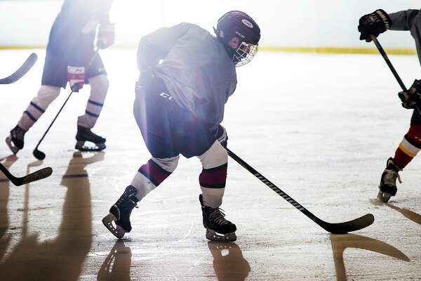 A member of the Manchester Flames under-16 hockey team takes part in practice on Nov. 24. Two weeks earlier, seven governors in the Northeast banded together to ban all interstate youth hockey until at least the end of the year.