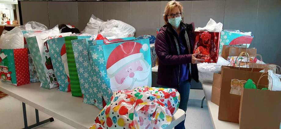 Nancy Fortin accepts gifts from the Christmas Carol Pillowcase Project that was donated for seniors. (Courtesy Photo)
