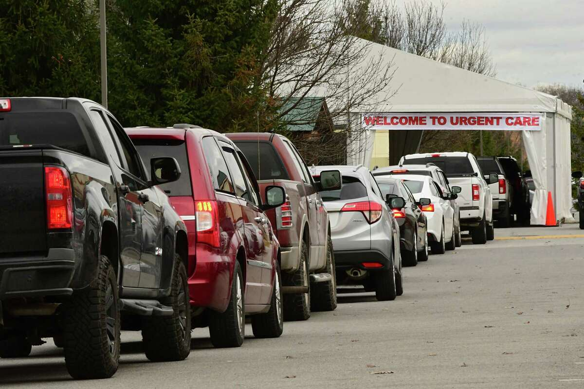 Cars are seen lined up at a drive-through COVID-19 testing tent set up in the Wilton Medical Arts parking lot on Friday, Dec. 4, 2020 in Wilton, N.Y. (Lori Van Buren/Times Union)