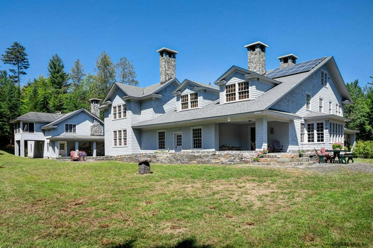 The Masten House, built in 1927, is a historic, very private retreat property nestled in the Adirondack wilderness on the edge of the High Peaks, undeveloped Henderson Lake and headwaters of the Hudson River. The grand mansion features a large modern kitchen, 8 bedrooms, 10 fireplaces and a guest house. View listing.