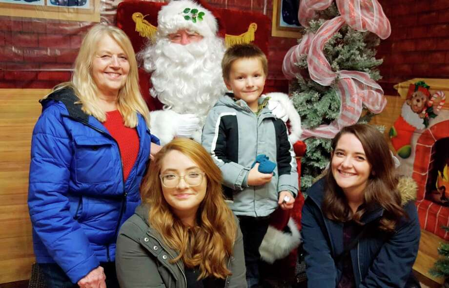 In this 2017 photo, Pioneer columnist Catherine Sweeney takes her nephew, Jackson Sweeney, on a trip to see Santa Claus. Also pictured is her grandmother, Elaine Lasky (left) and sister, Kelli Sweeney (right).