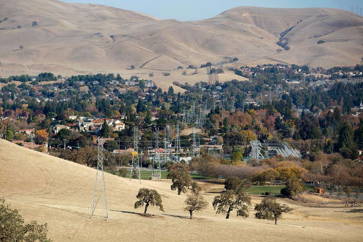Dry grass covers the rolling hills surrounding Concord, Calif. on Friday, December 4, 2020. High winds are expected in the coming days leaving the Bay Area vulnerable to increased fire dangers.