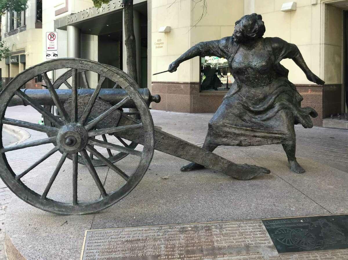 A bronze statue depicts innkeeper Angelina Belle Peyton Eberly across Congress Avenue in Austin.