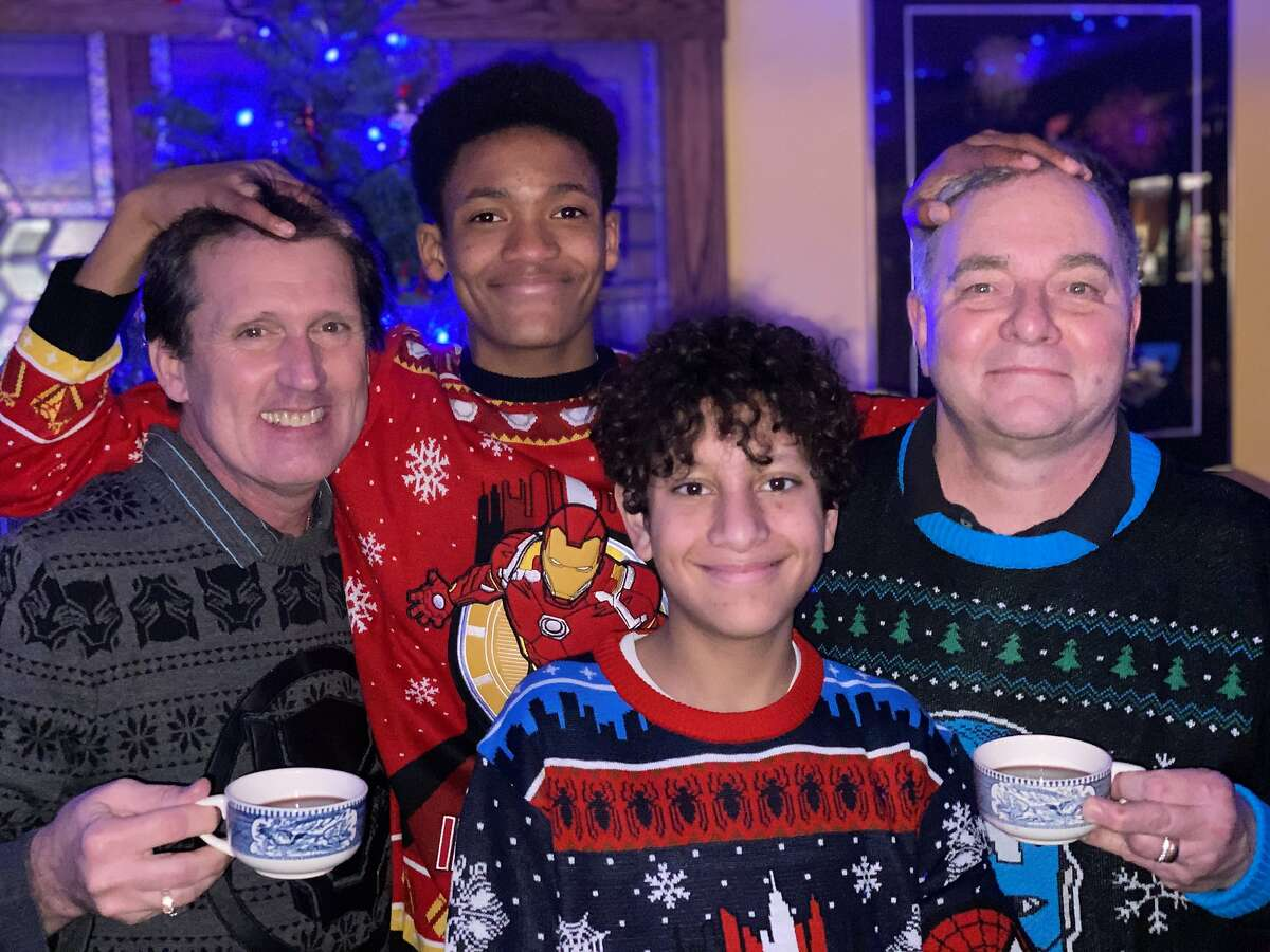 Brian (left), Zane, Aidan and Kevin Fisher-Paulson posing for their 2020 Christmas card.